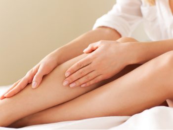 a lady enjoying the results of laser hair removal on her legs