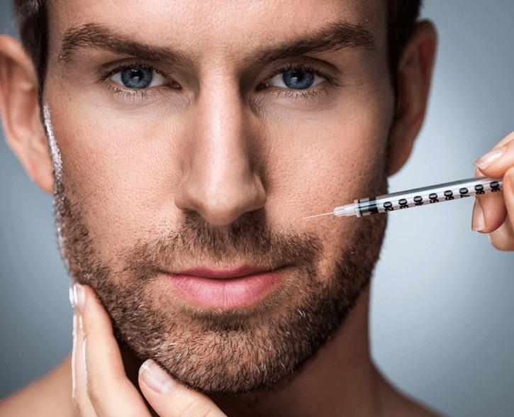 bearded man getting facial dermal filler